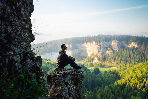 man sitting on the top of the mountain, leisure in - mindfulness stock photos and pictures