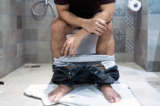 Royalty Free Man Sitting On Toilet Pictures, Images and
