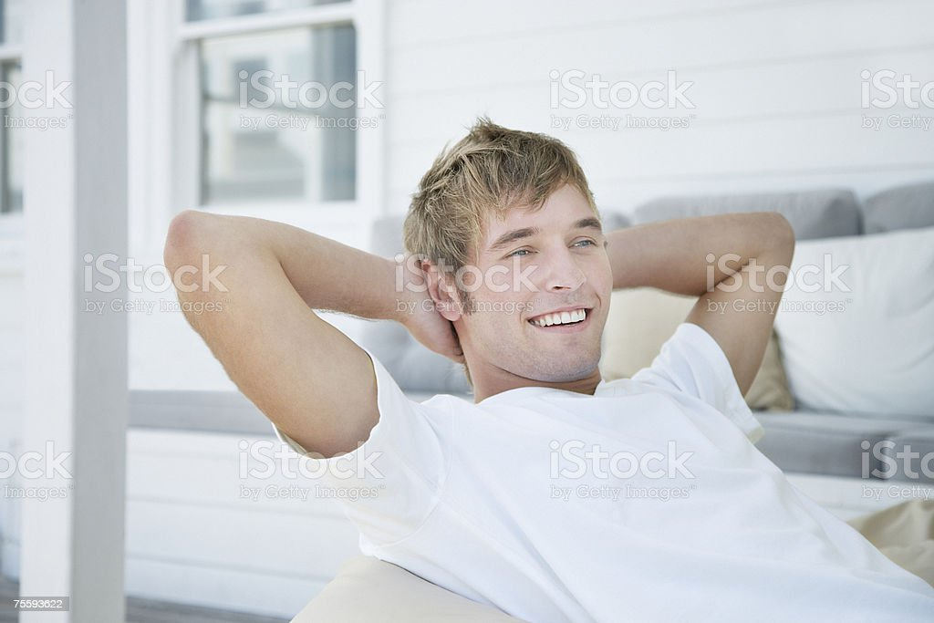 Man sitting outdoors relaxing and smiling royalty-free stock photo