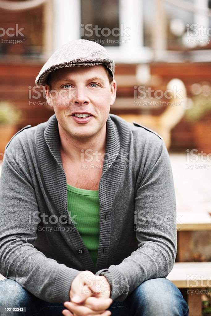 Man sitting outside his home royalty-free stock photo