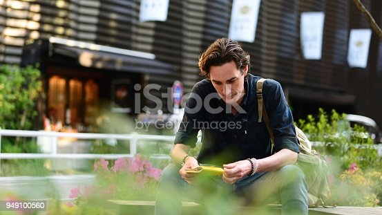 istock Man sitting outside 949100560