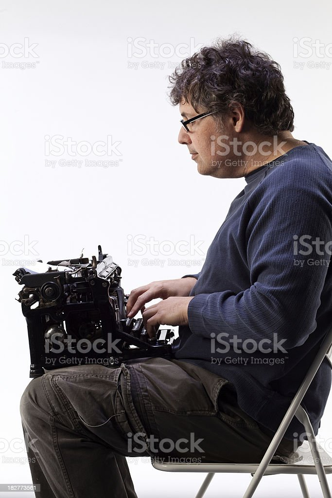Man sitting with a typewriter in his lap. royalty-free stock photo