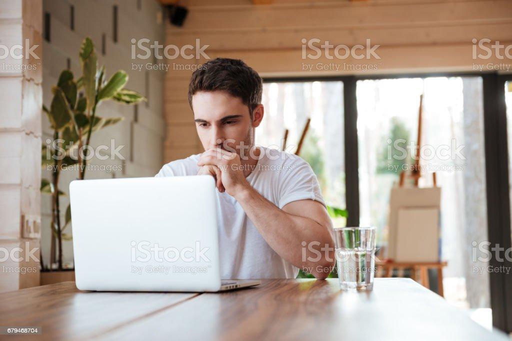 man siyying near laptop royalty-free stock photo