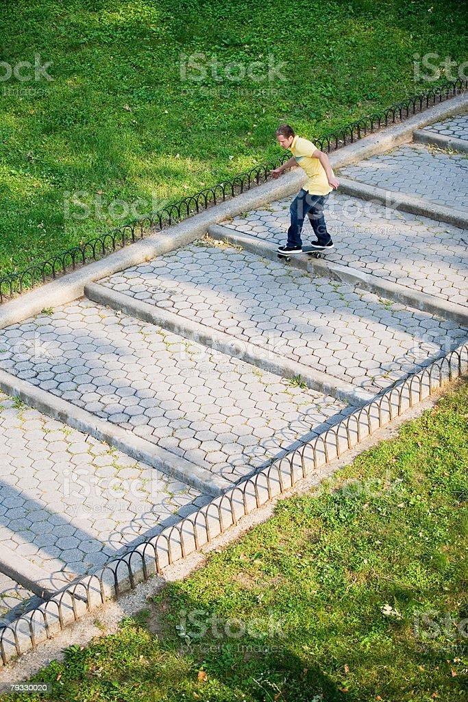 A man skateboarding down steps 免版稅 stock photo