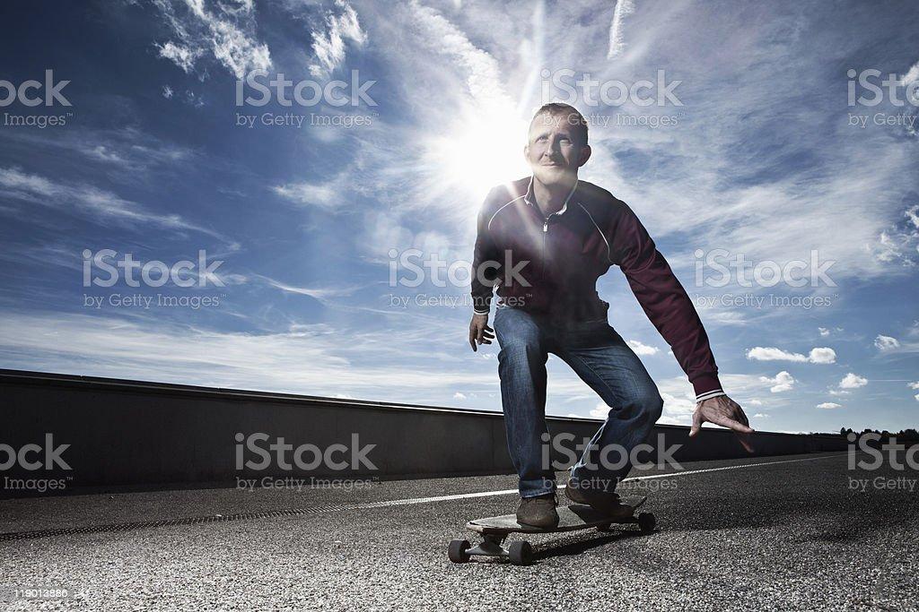 Man skating on longboard stock photo