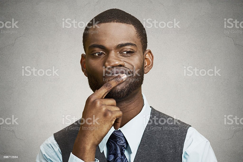 Man skeptic, confused, thinking stock photo