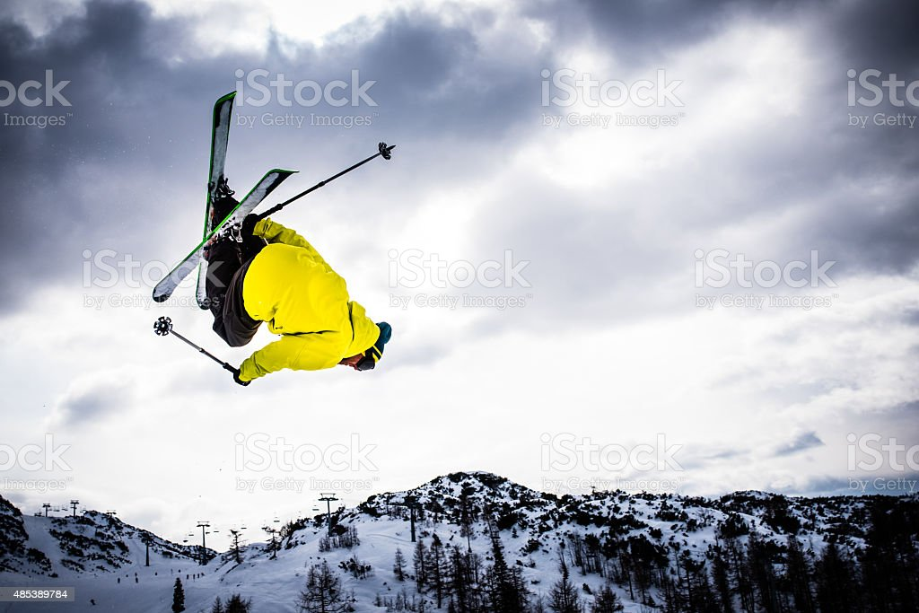 Man ski jumping stock photo