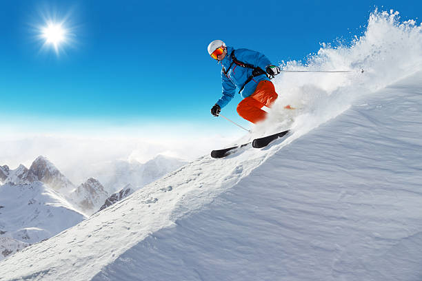 Man skier running downhill Man skier running downhill on sunny Alps slope ski stock pictures, royalty-free photos & images