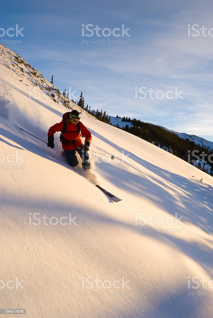 Man Skiing Powder in Colorado stock photo