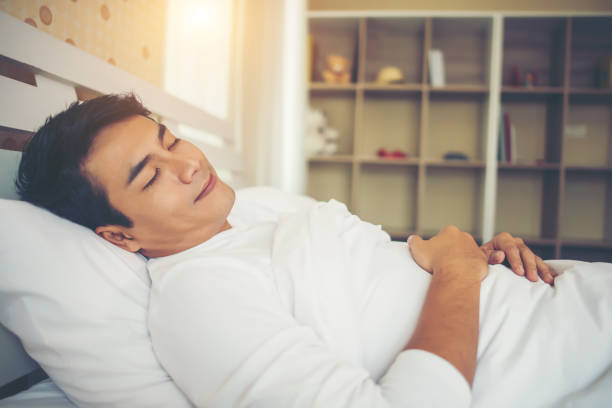 Man Sleep in the bedroom stock photo