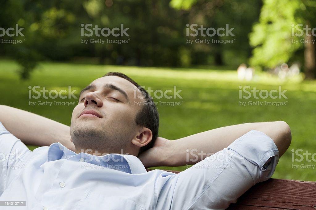 Man sleep on bench stock photo