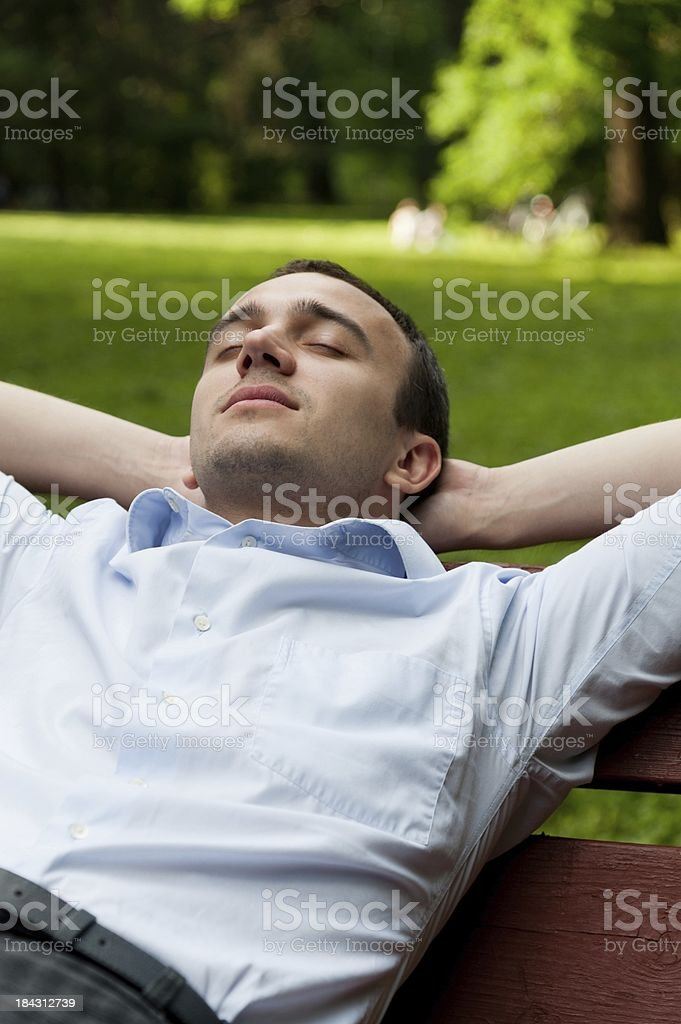Man sleep on the bench stock photo