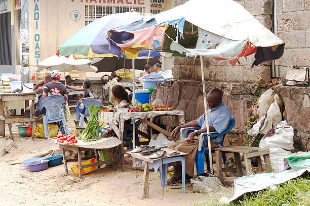 man sleeping at market stall, kinshasa - democratic republic of the congo stock photos and pictures