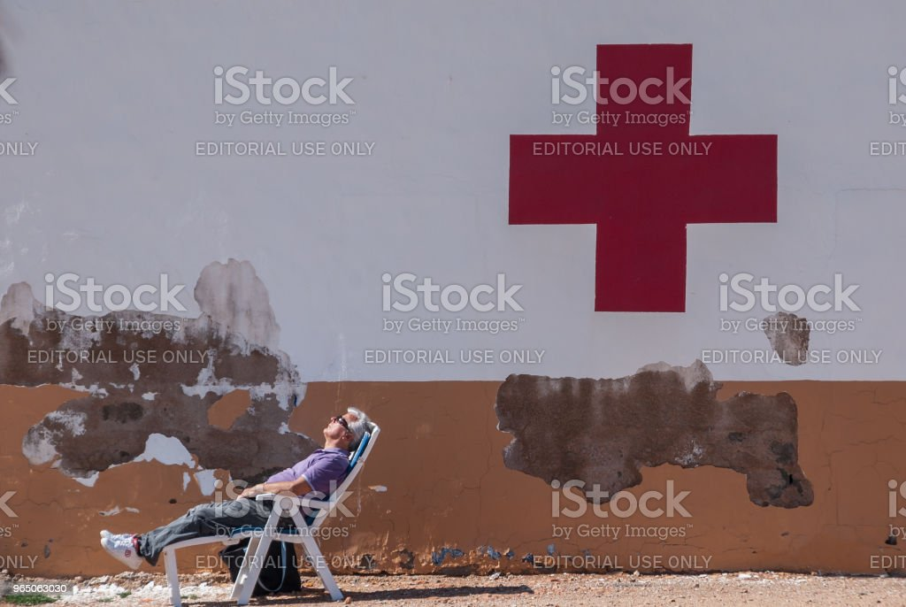 Man sleeping at the aid post of the Mar Menor in Murcia in February 2011 royalty-free stock photo