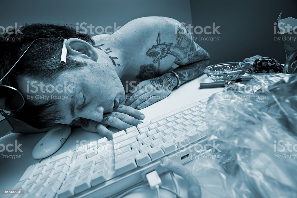 Man sleeping at the computer royalty-free stock photo