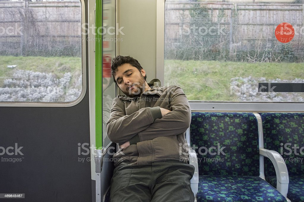 Man, sleeping in a fast moving subway royalty-free stock photo