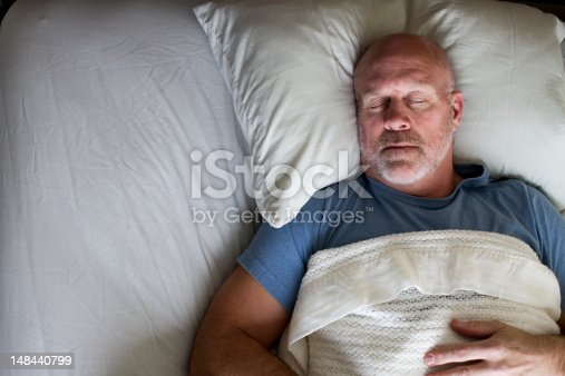 istock Man Sleeping in Bed 148440799