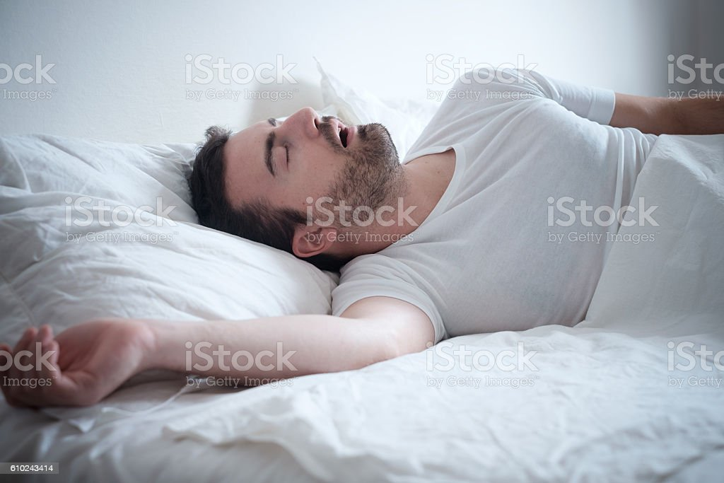 Man sleeping in his bed and snoring loudly – Foto
