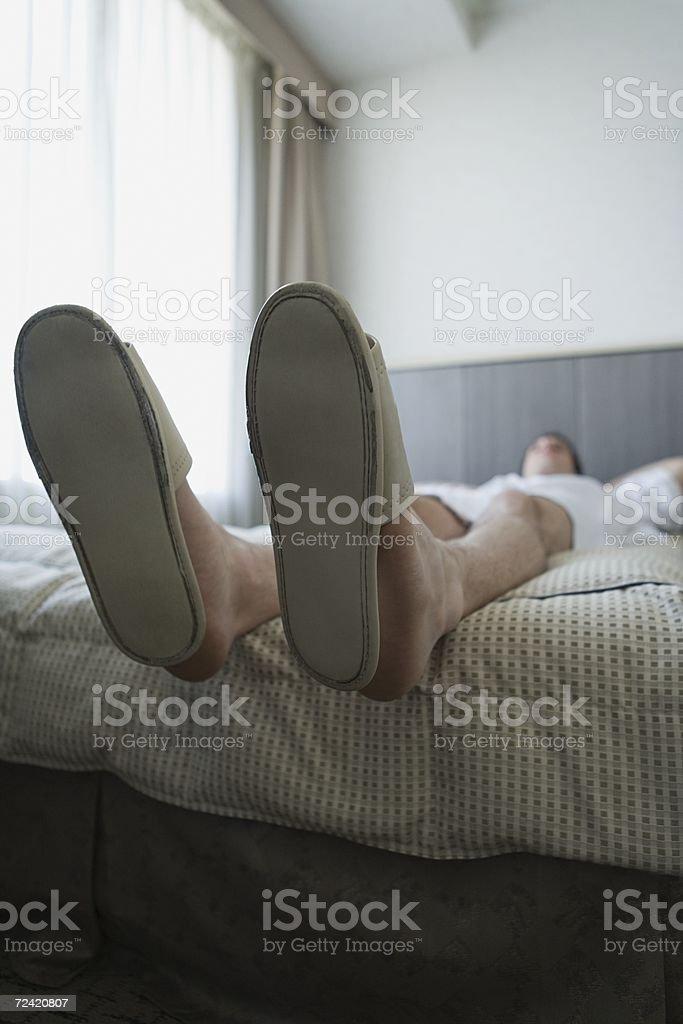 Man sleeping on bed royalty-free stock photo