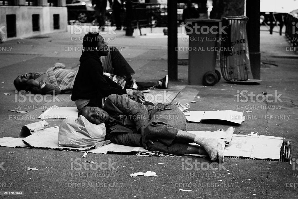 Man sleeping on the street in Paris stock photo