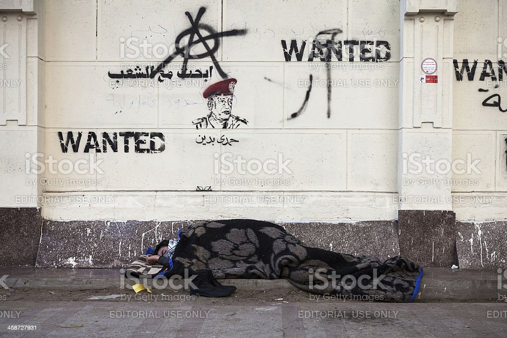 Man sleeping outside Ministry Of Health in Cairo stock photo