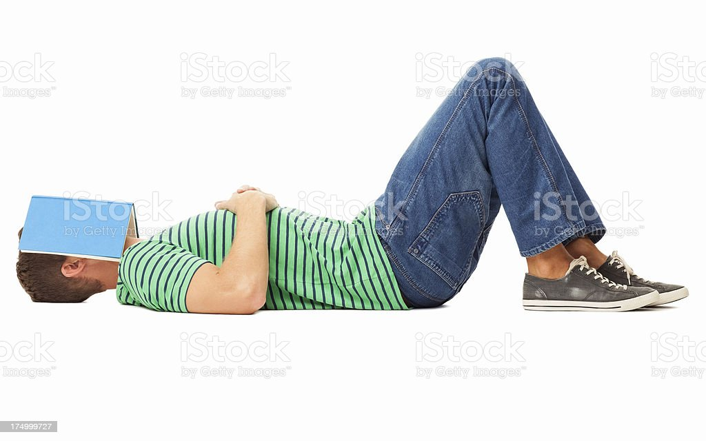 Man Sleeping With Book On Face - Isolated stock photo