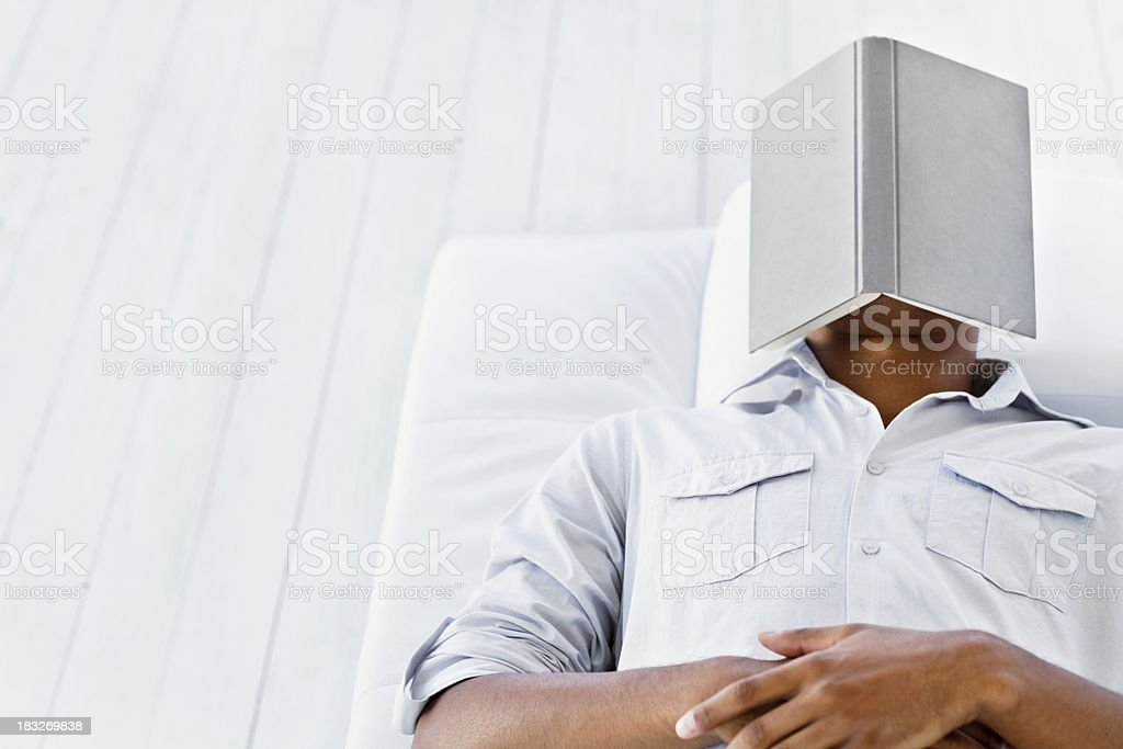 Man Sleeping with Book on Face royalty-free stock photo