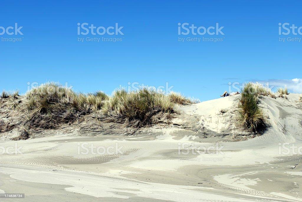 Man sleeps on Sand Dune Horizon royalty-free stock photo