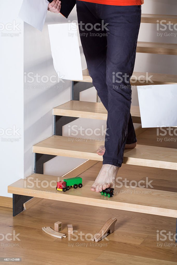 Man slip on a toy stock photo