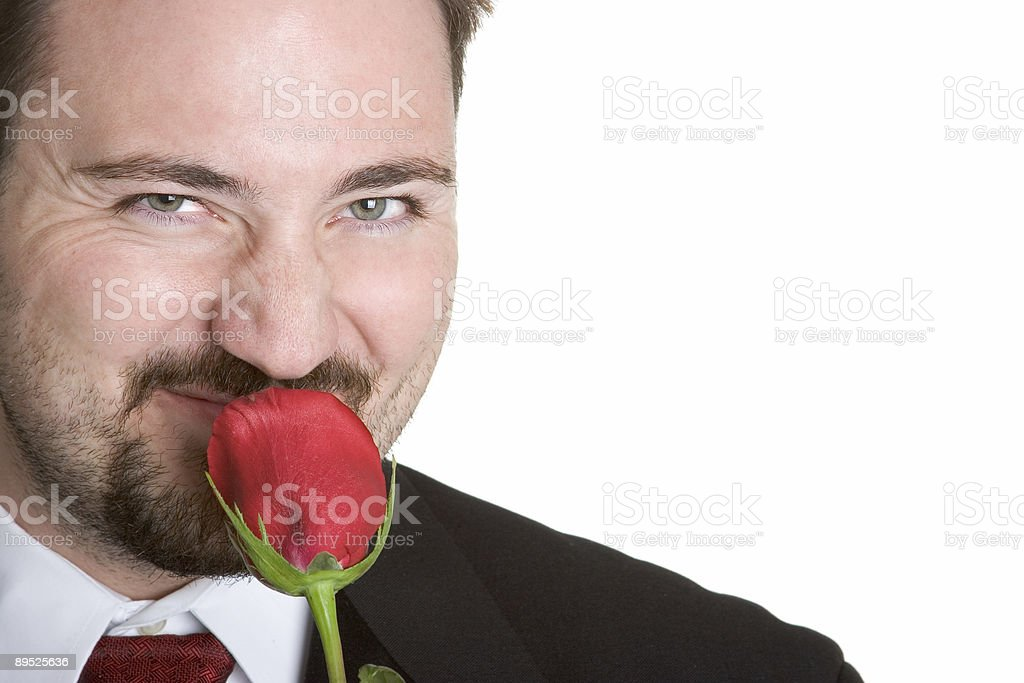 Man smelling a rose royalty-free stock photo
