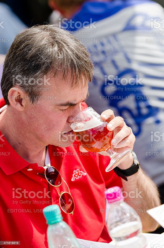 Man smelling and tasting beer royalty-free stock photo