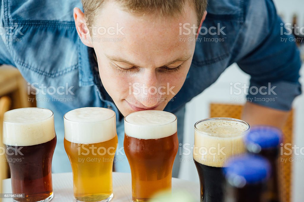 Man smelling craft beer stock photo