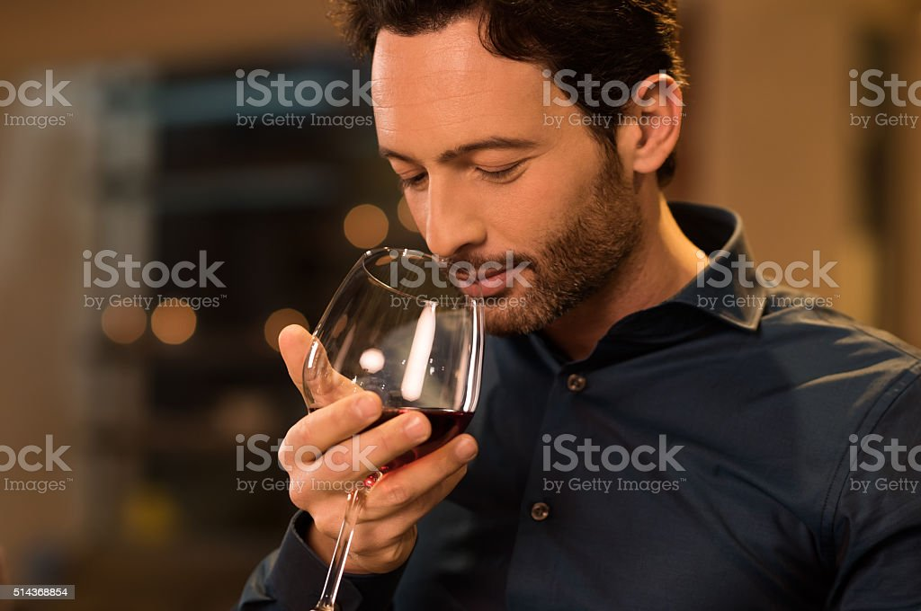 Man smelling red wine stock photo
