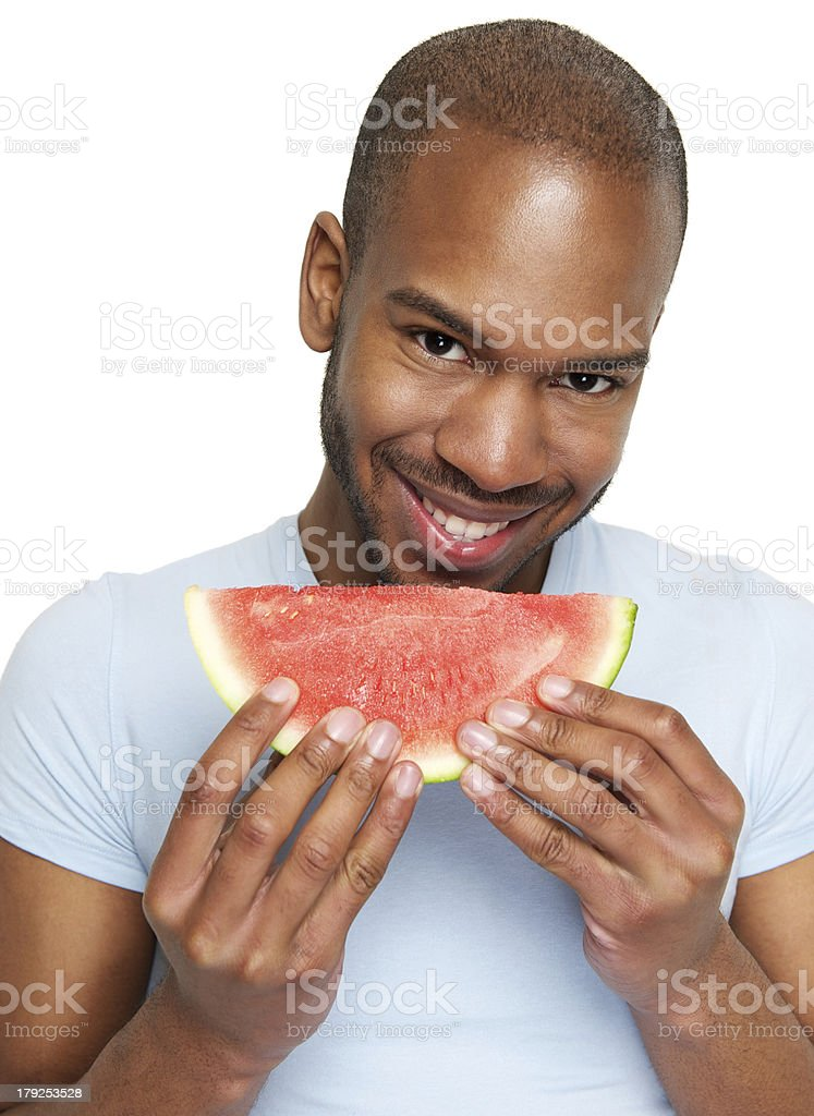 Man smiling and eating delicious watermelon stock photo