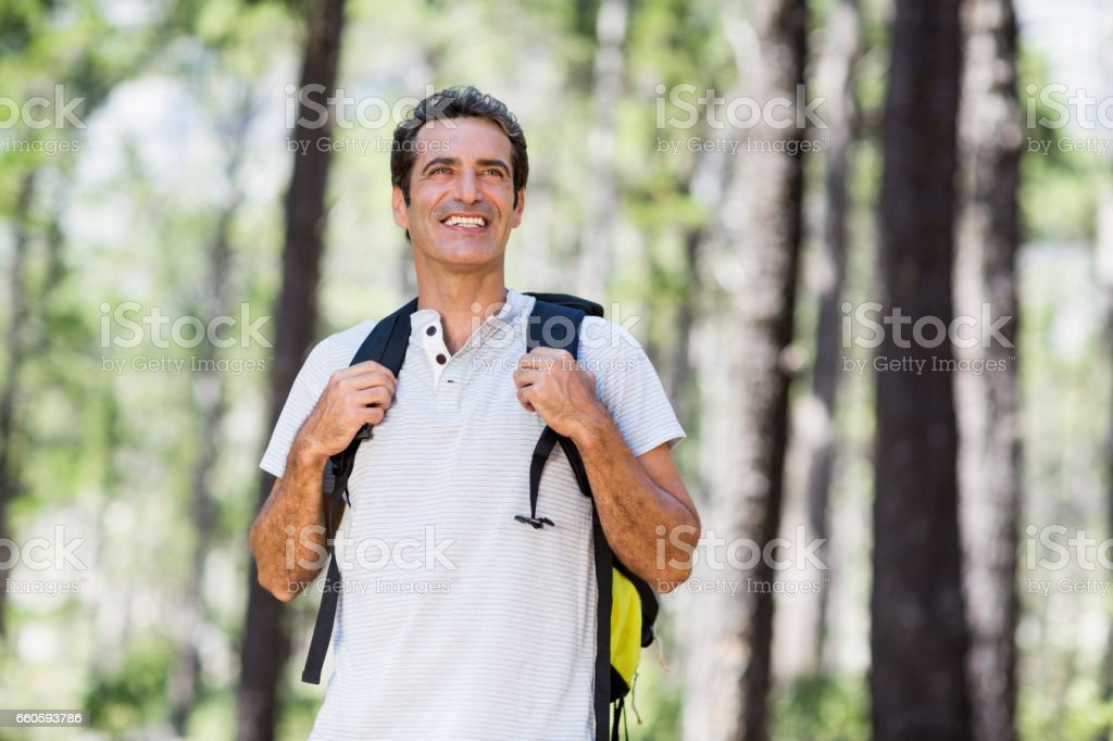 Man smiling and posing with his backpack royalty-free stock photo