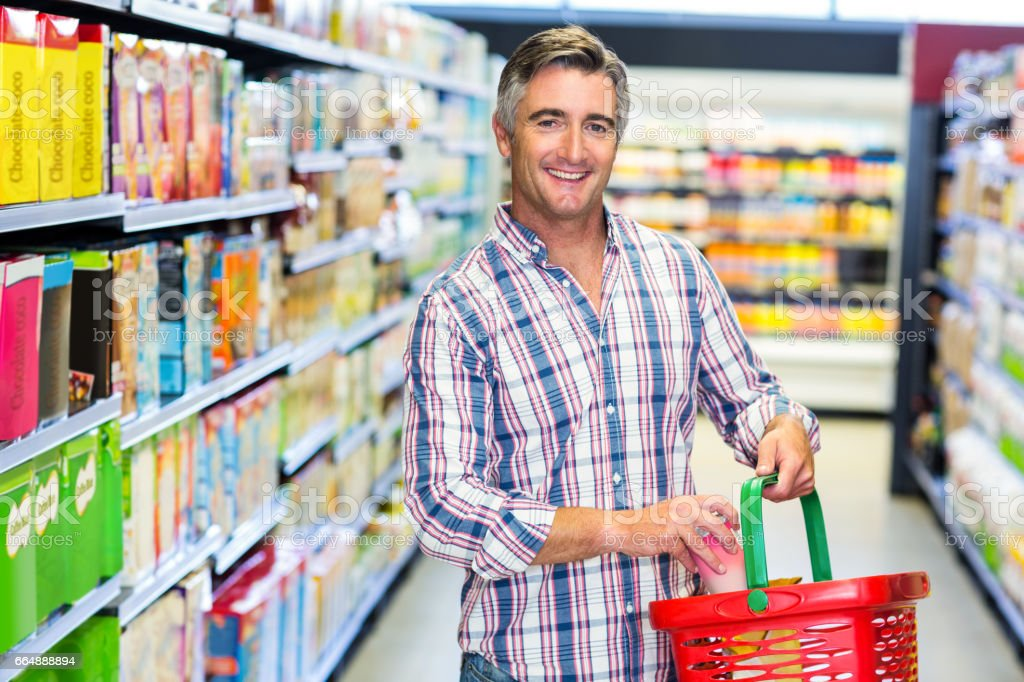 Man smiling at the camera while buying food foto stock royalty-free