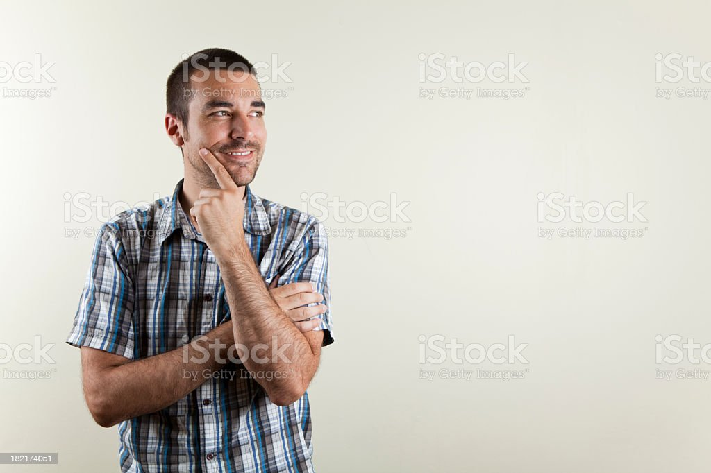 A man smiling because he has an idea stock photo