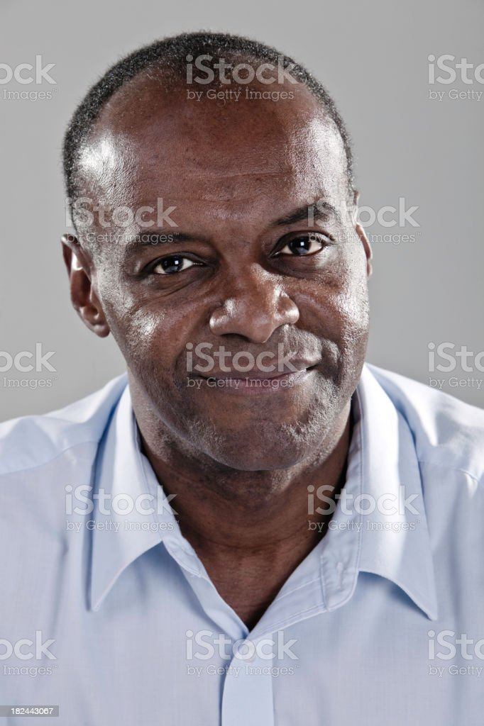 Man smiling for camera on gray background royalty-free stock photo