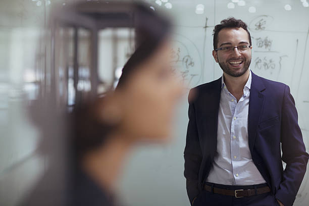 Man smiling in design studio office stock photo