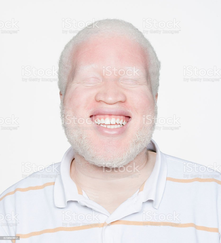 Man smiling with eyes closed stock photo