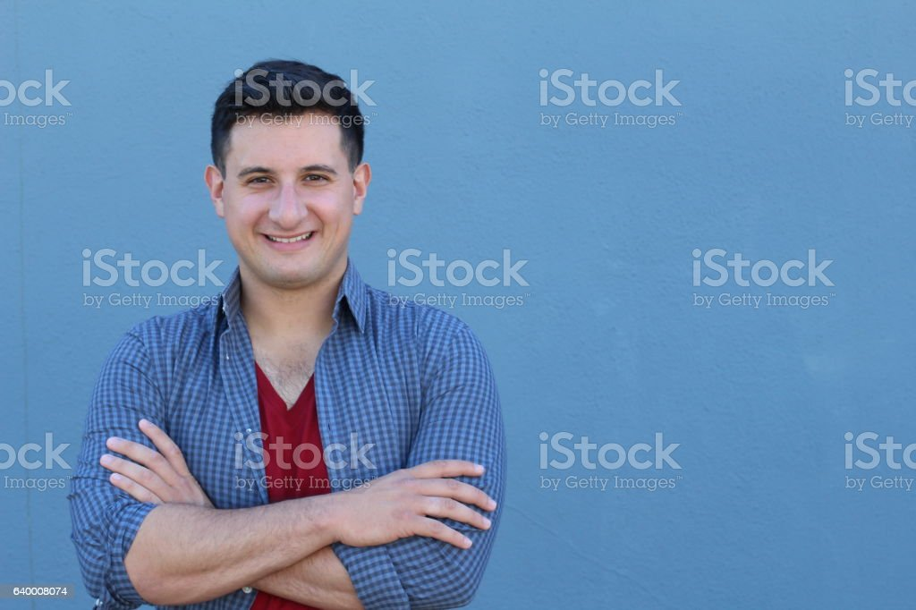 Man smiling with his arms crossed stock photo