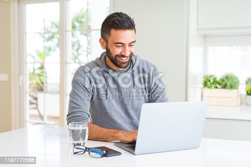 Man smiling working using computer laptop