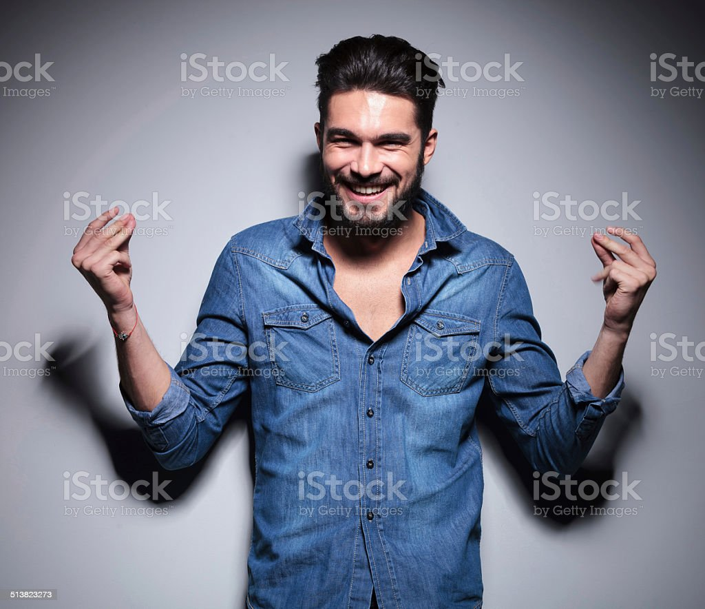 Man smilling and moving his hands stock photo