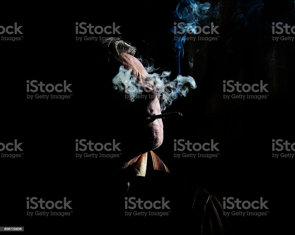 Man smoke cigarette whith black background 1 stock photo