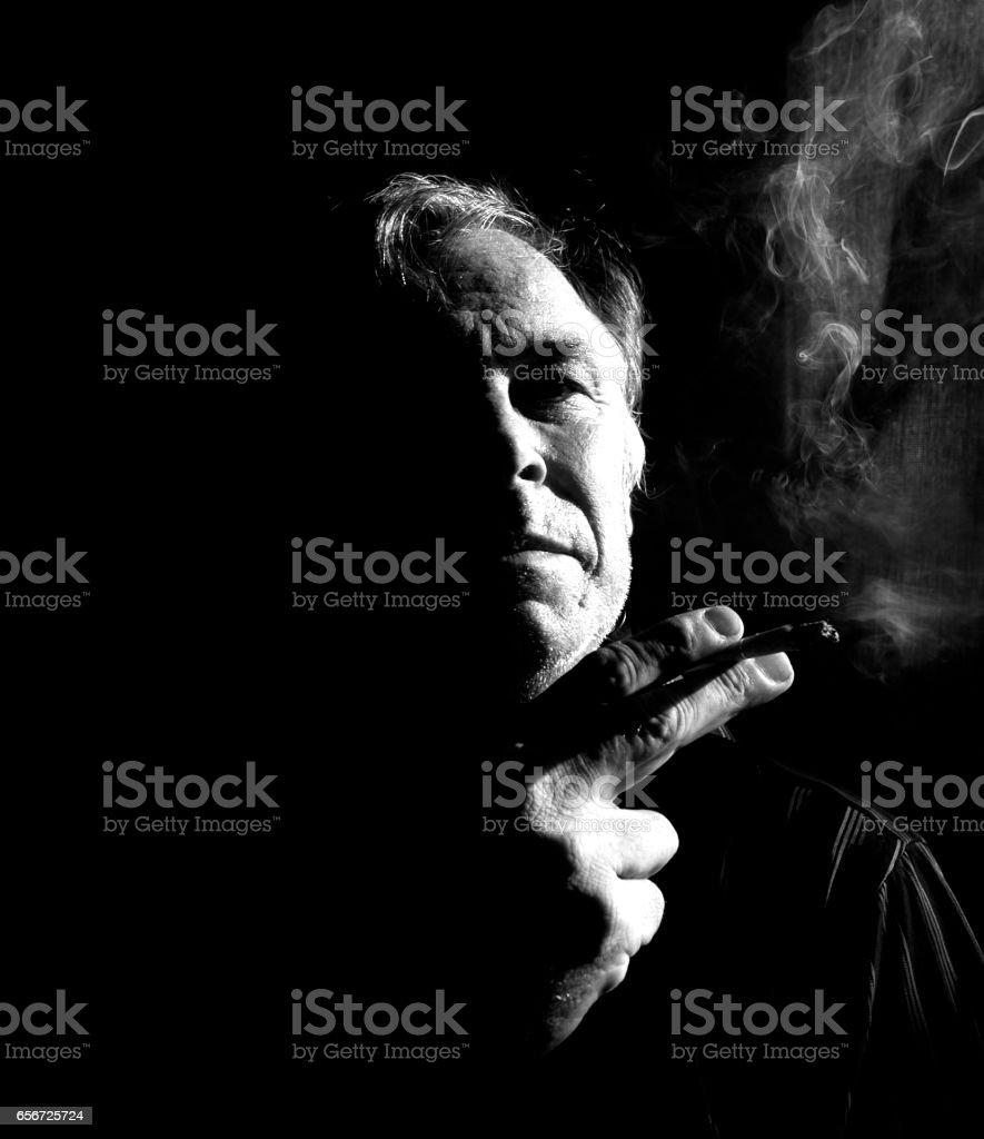 Man smoke cigarette whith black background 2 stock photo