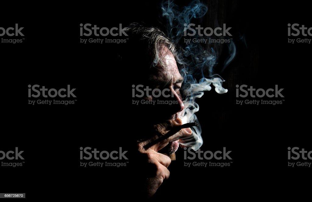 Man smoke cigarette whith black background 3 stock photo