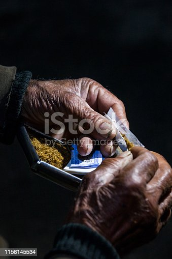 istock Man smoking a cigarette 1156145534