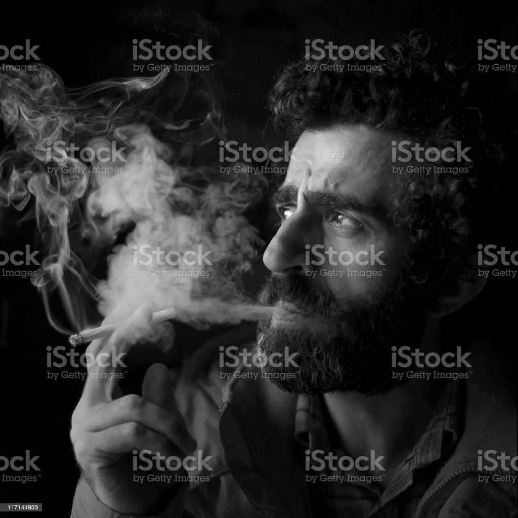 Man smoking a cigarette. royalty-free stock photo