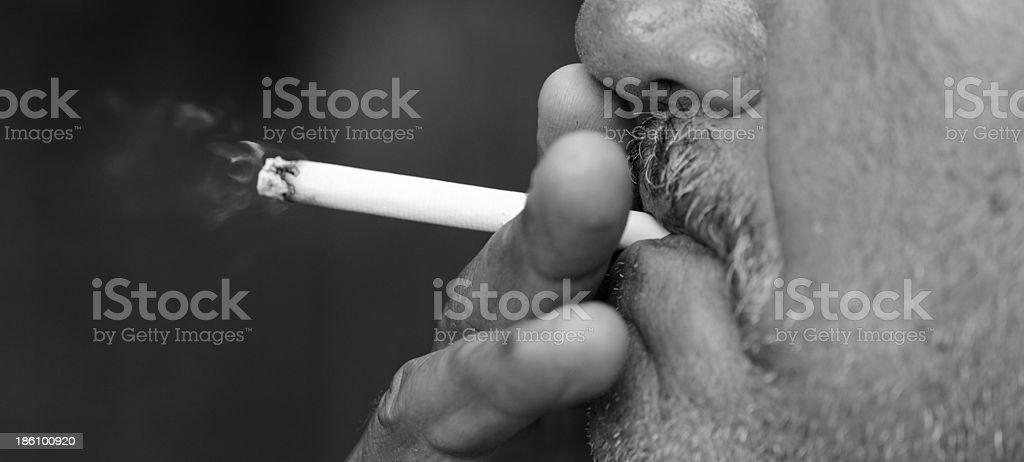 Man smoking a cigarette royalty-free stock photo