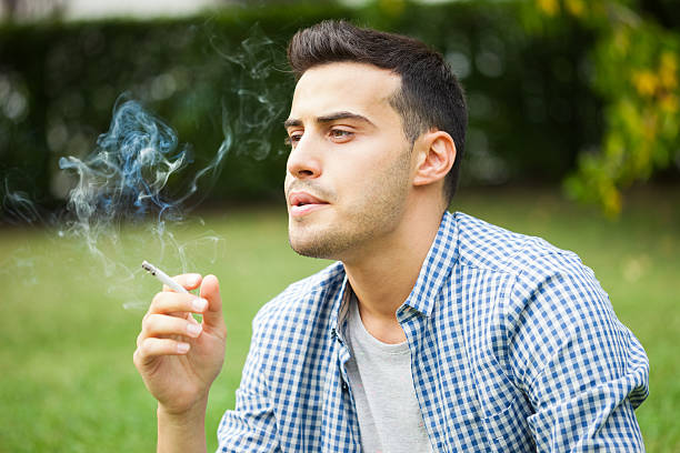 Man smoking a cigarette stock photo